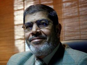 Fig. 97 - Il Presidente egiziano Moḥamed Morsi